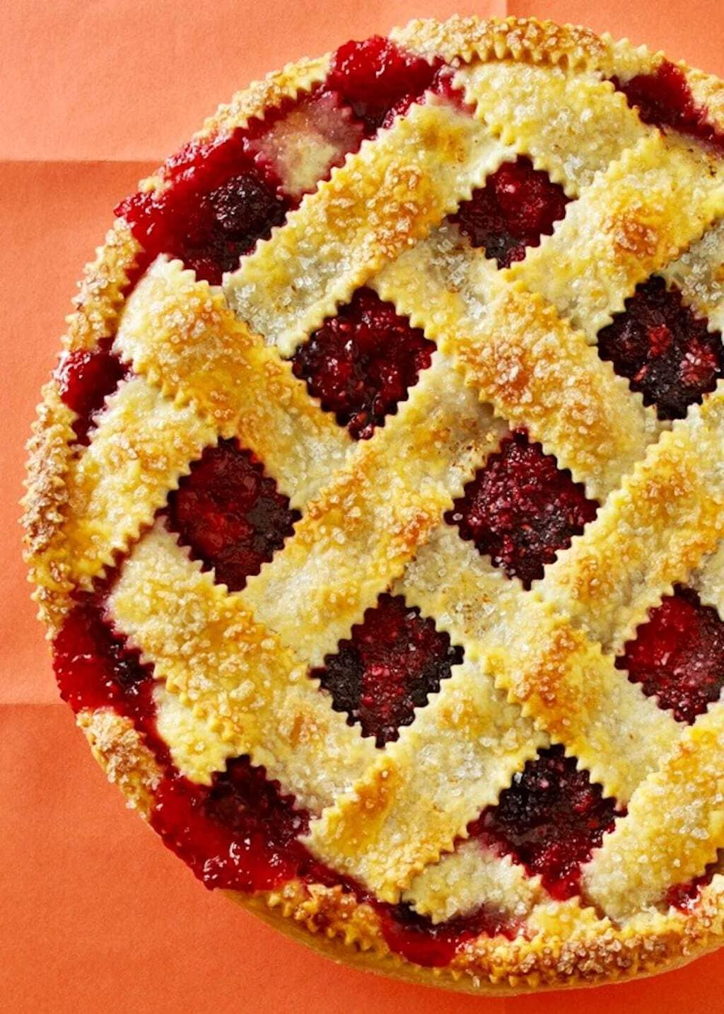 lattice top razzleberry pie on orange paper