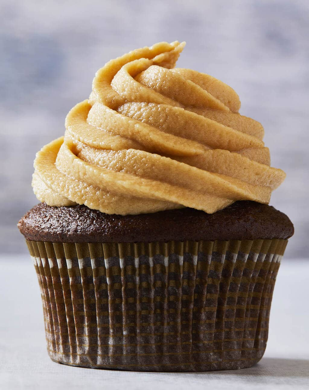 chocolate cupcake with piped peanut butter frosting