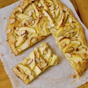 rustic apple tart with sliced almonds on top