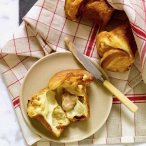 apple popover open on plate with maple butter