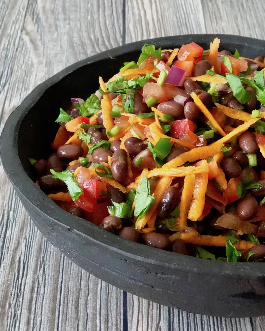 Healthy Taco Salad with black beans shredded carrots and cilantro in a bowl