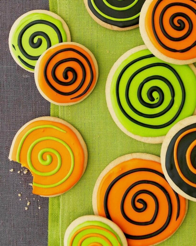 Spooky spiral halloween cookies with orange green and black frosting
