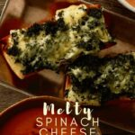 Melty spinach cheese toasts on a tray