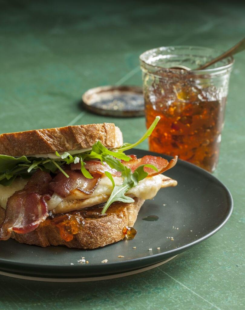 bacon chicken sandwich with pepper jelly in a jar