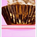 closeup of coconut haystack with white chocolate in foil cupcake wrapper