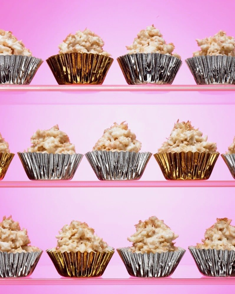 white chocolate candy haystacks in metallic cups on pink background