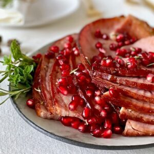 holiday ham with pomegranate on platter