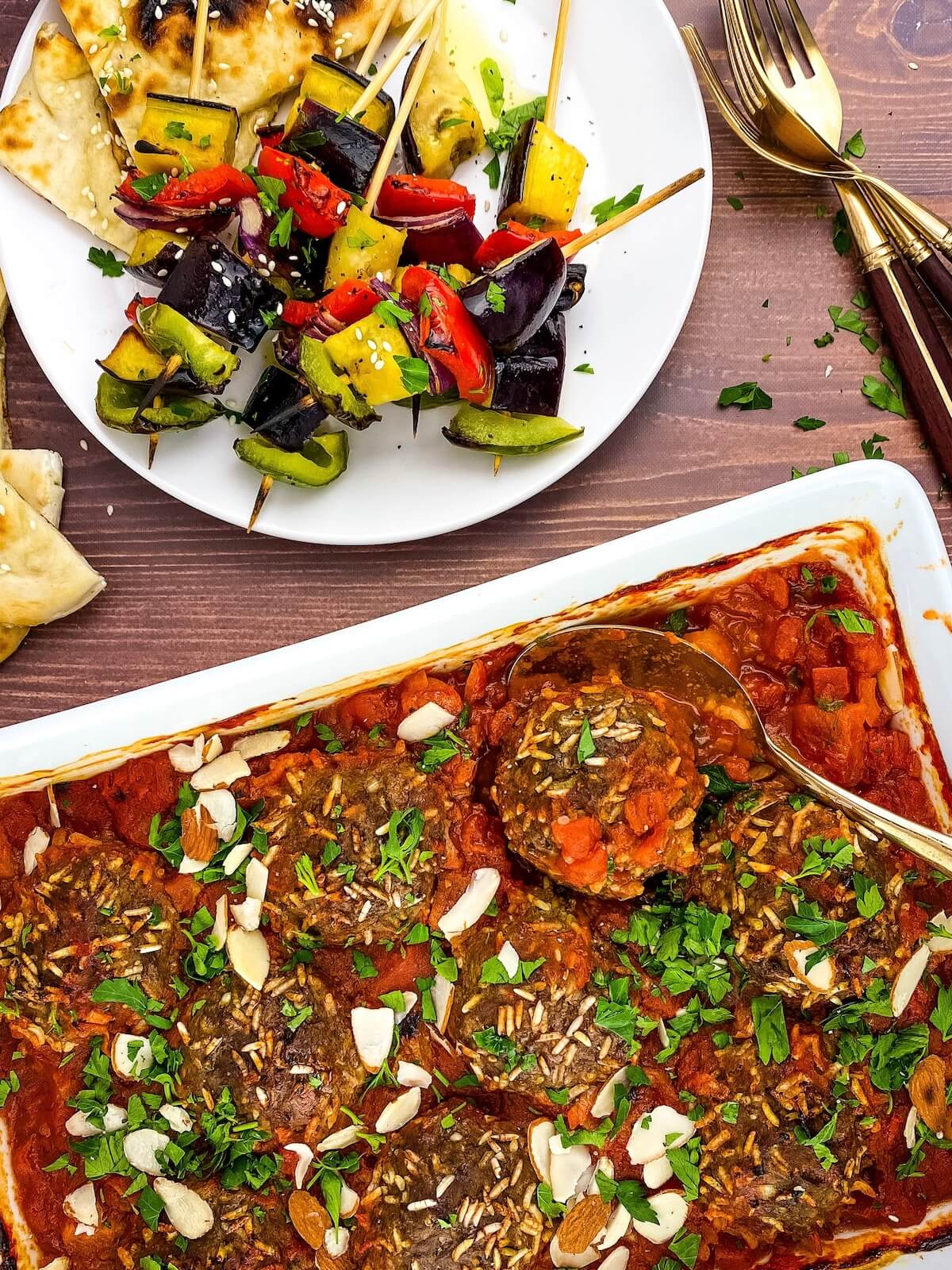 porcupine meatballs in baking dish with vegetable kabobs