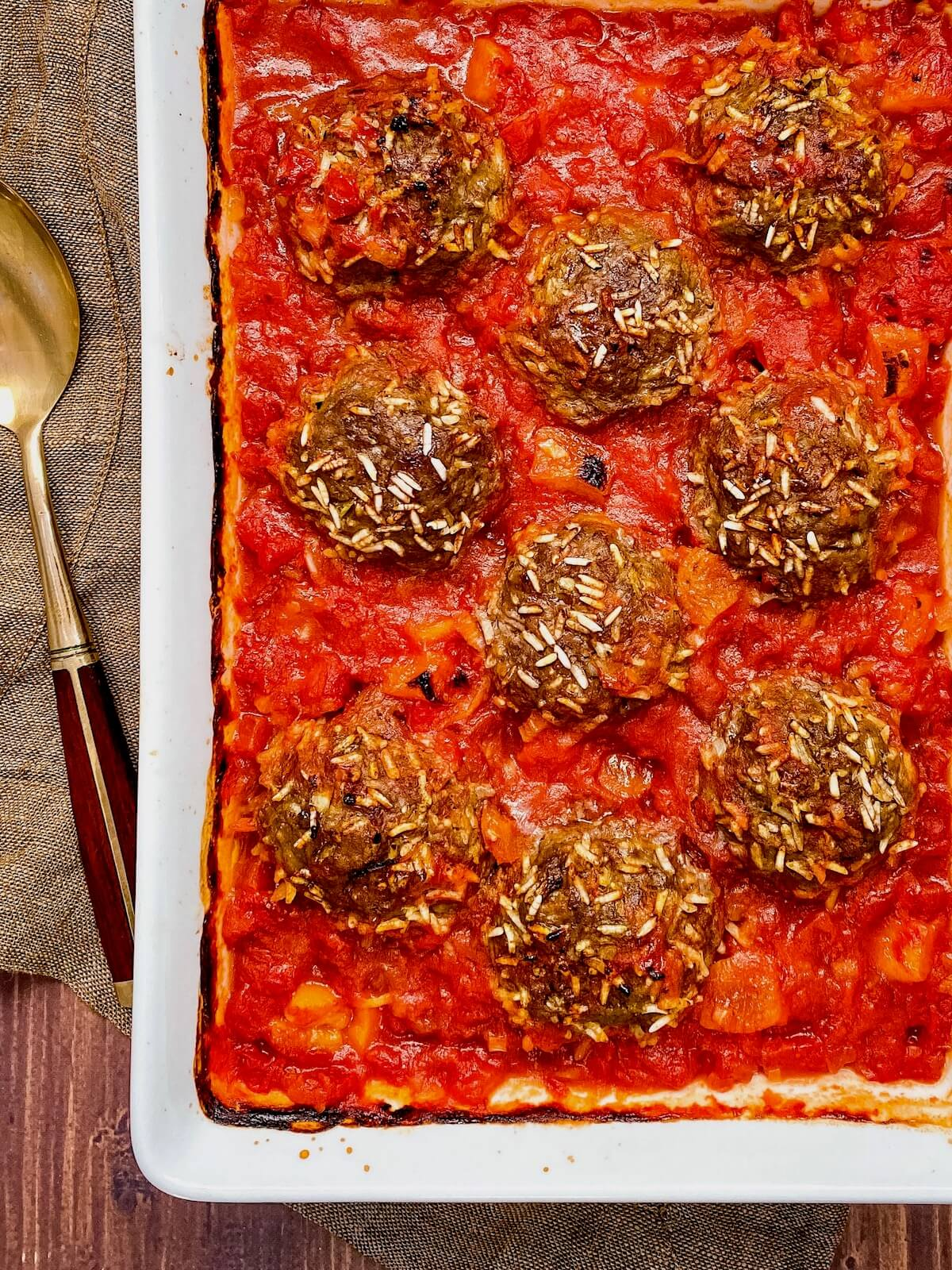 baked Moroccan meatballs in white dish