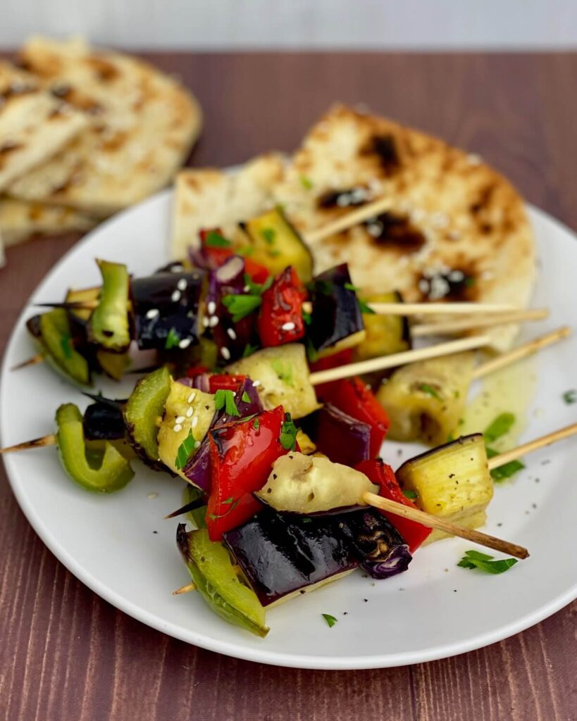 vegetable kababs with pita bread on plate