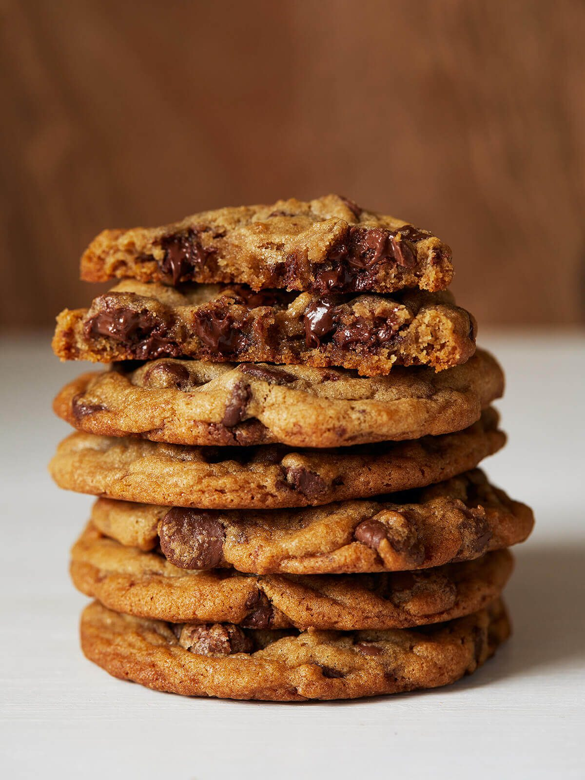 melty chocolate chips in stack of cookies
