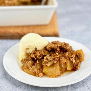 serving of apple crisp on white plate