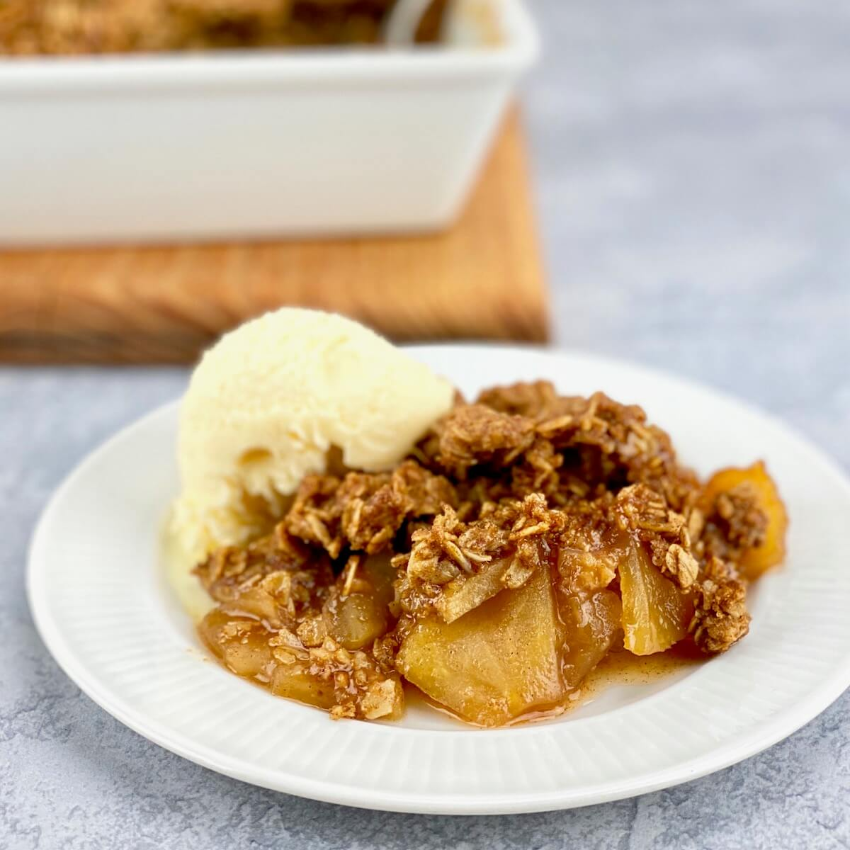 serving of apple crisp on white plate