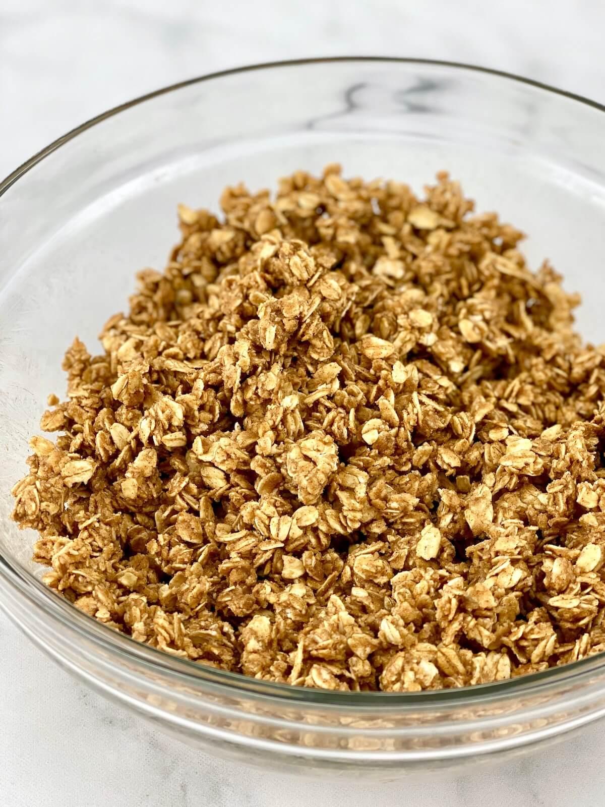 apple crisp oat topping in medium-size glass bowl