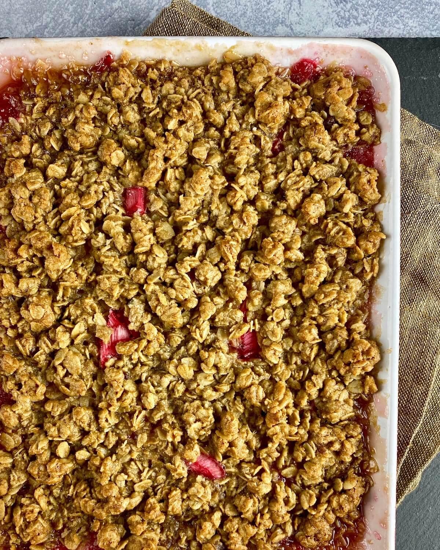baked rhubarb crisp in dish on towel