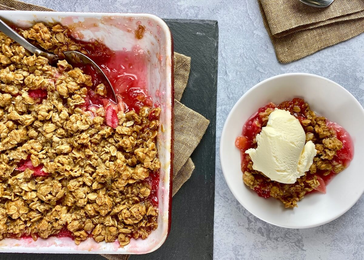 rhubarb crisp being served with ice cream