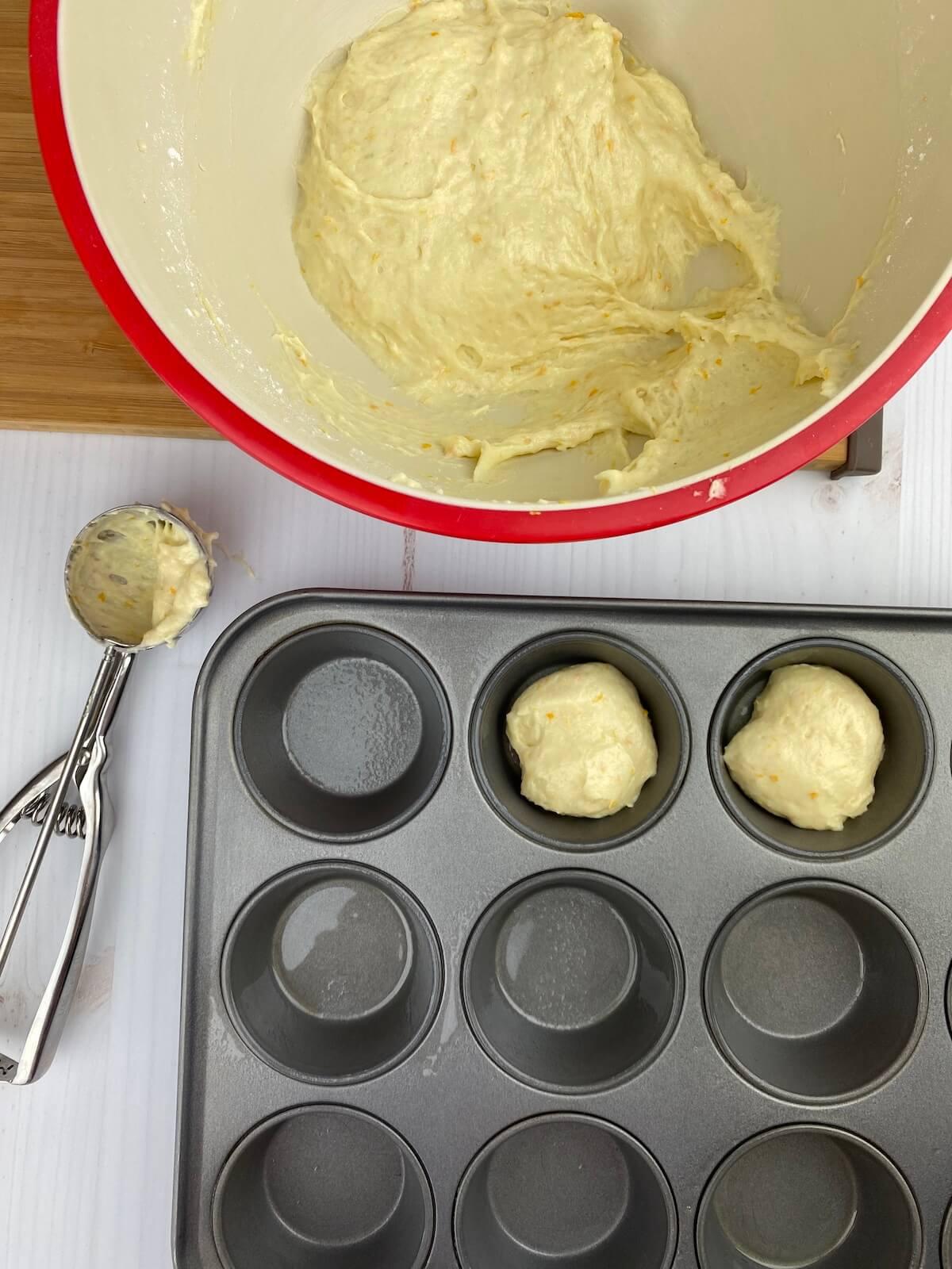gluten free orange muffins prep with muffin tin