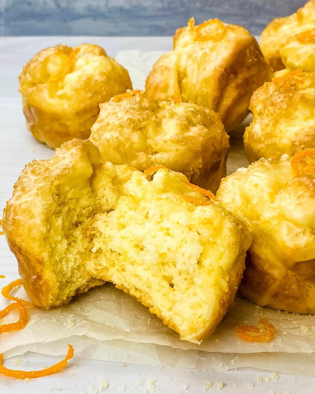 broken open orange muffin with zest