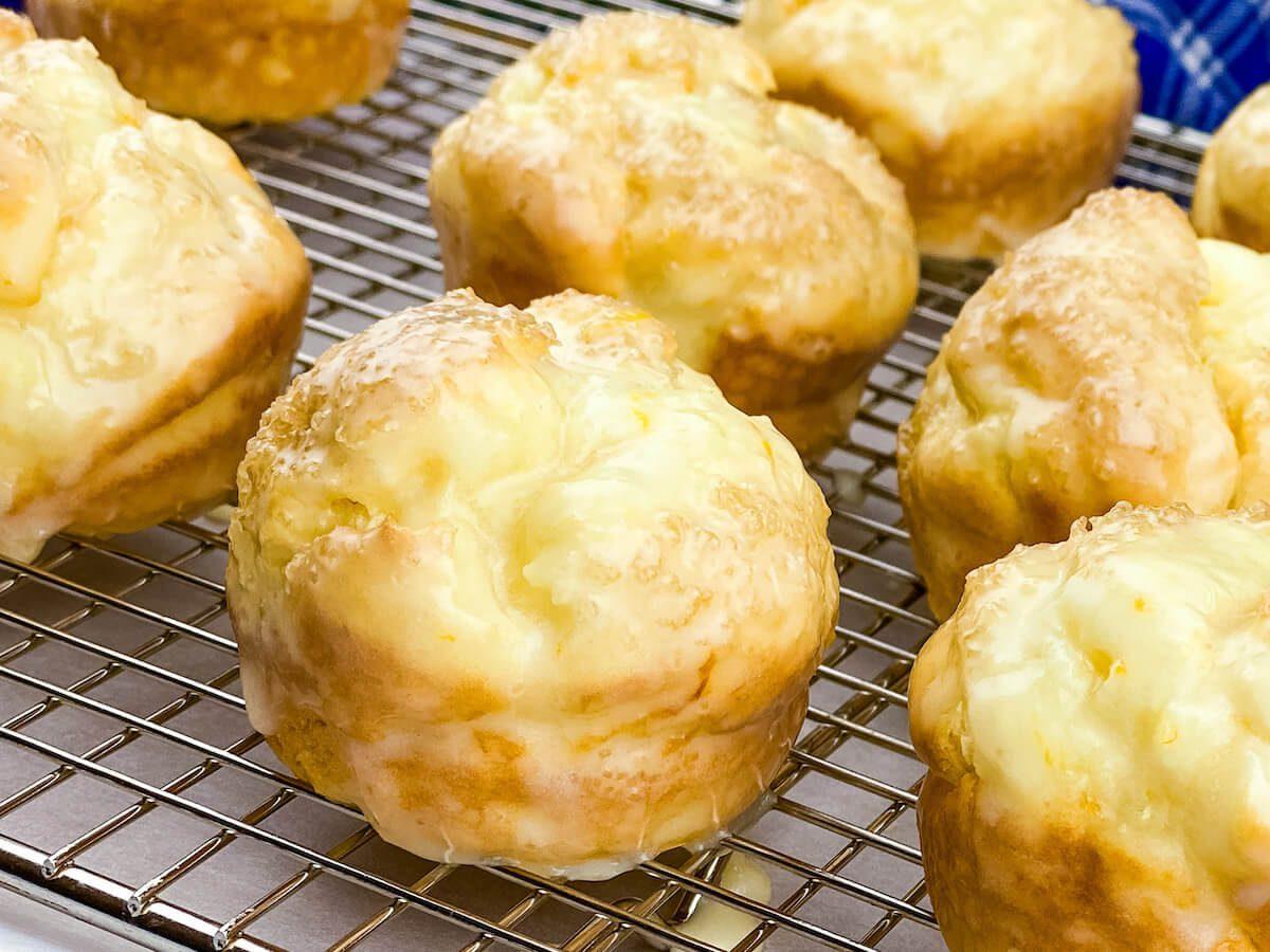 glazed orange muffins on rack
