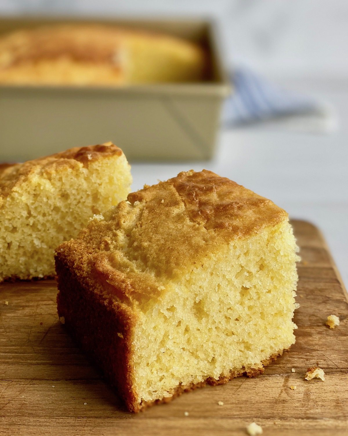 tall slice of moist cornbread on board