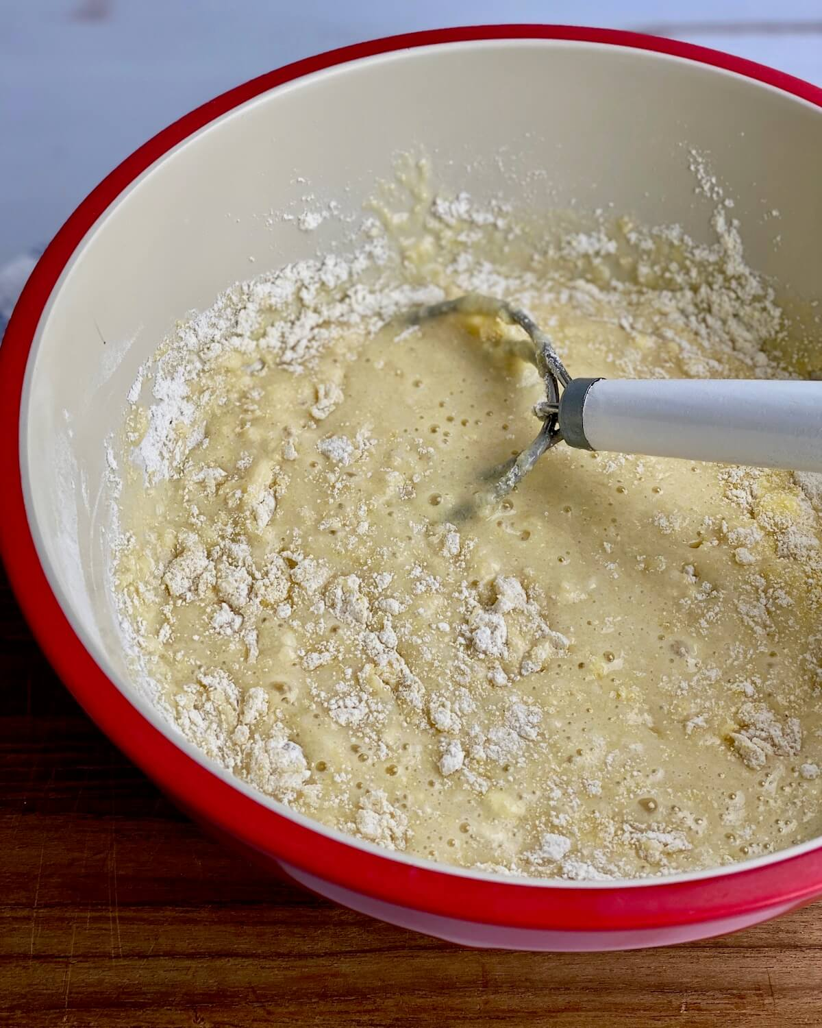 cornbread batter in red bowl