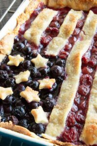 blueberry and cherry desseret with star and stripe pastry on top