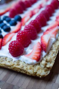 slice of cookie cake on a wooden cutting board