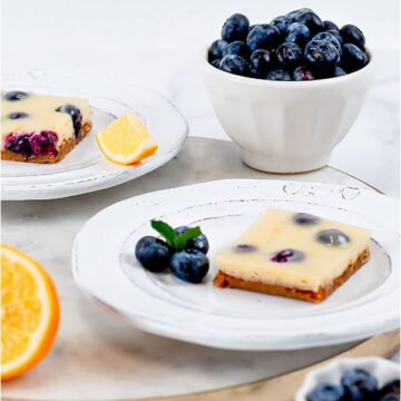 Lemon-blueberry bars on a circle cutting board