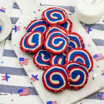 Pinwheel cookies on a white platter.