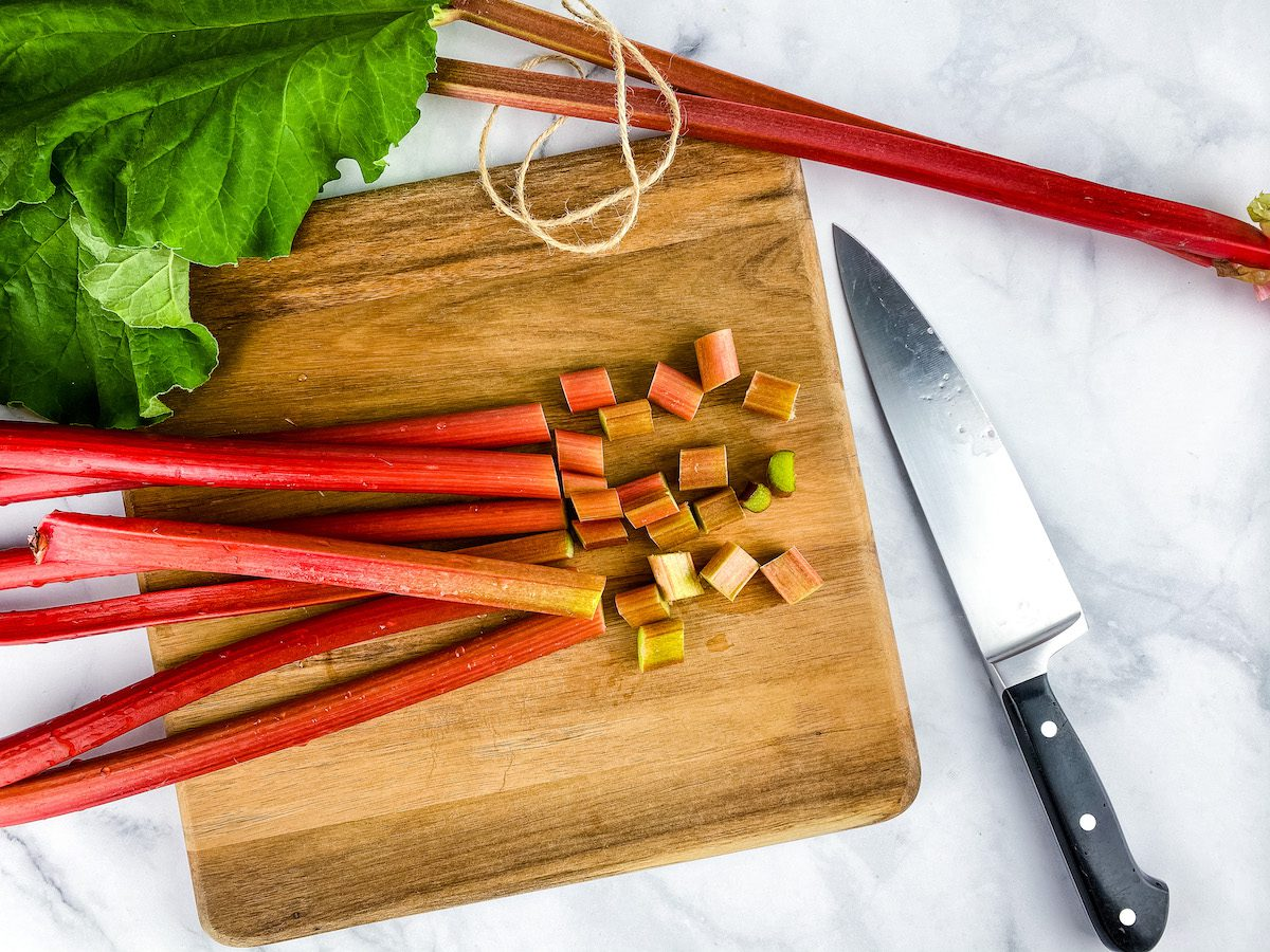 cutting rhubarb on a wood cutting board