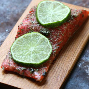 Salmon on wooden cutting board