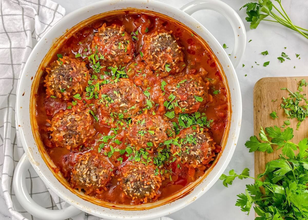 beef meatballs with rice in tomato sauce with fresh parsley on top