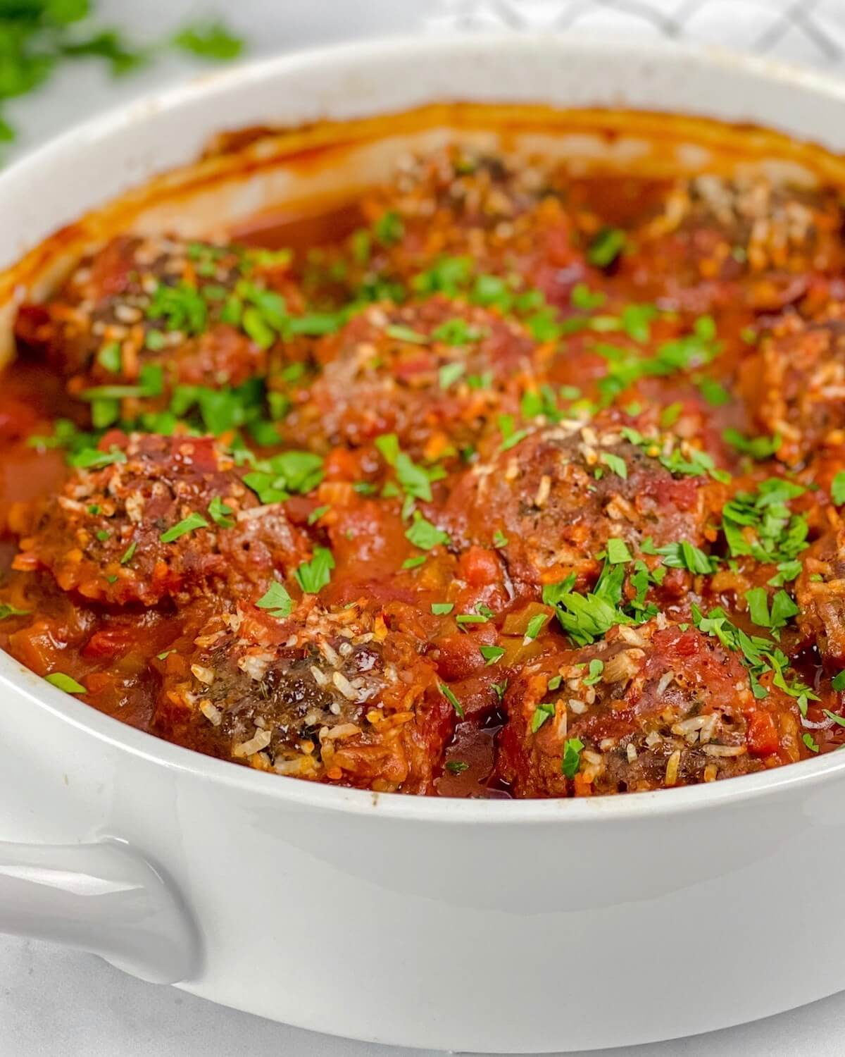 porcupine meatballs with rice in tomato sauce with parsley