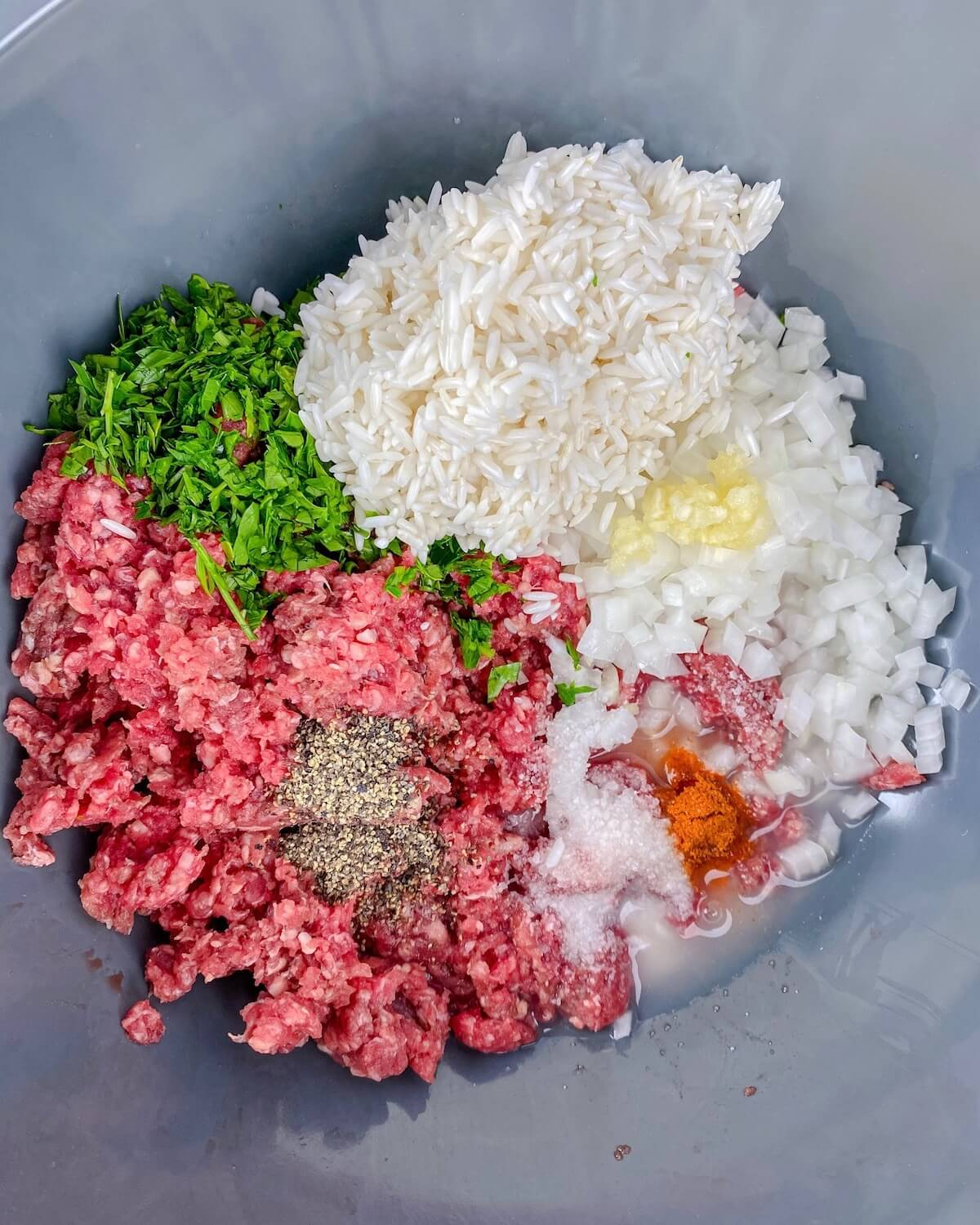 meatball mixture with rice in a bowl