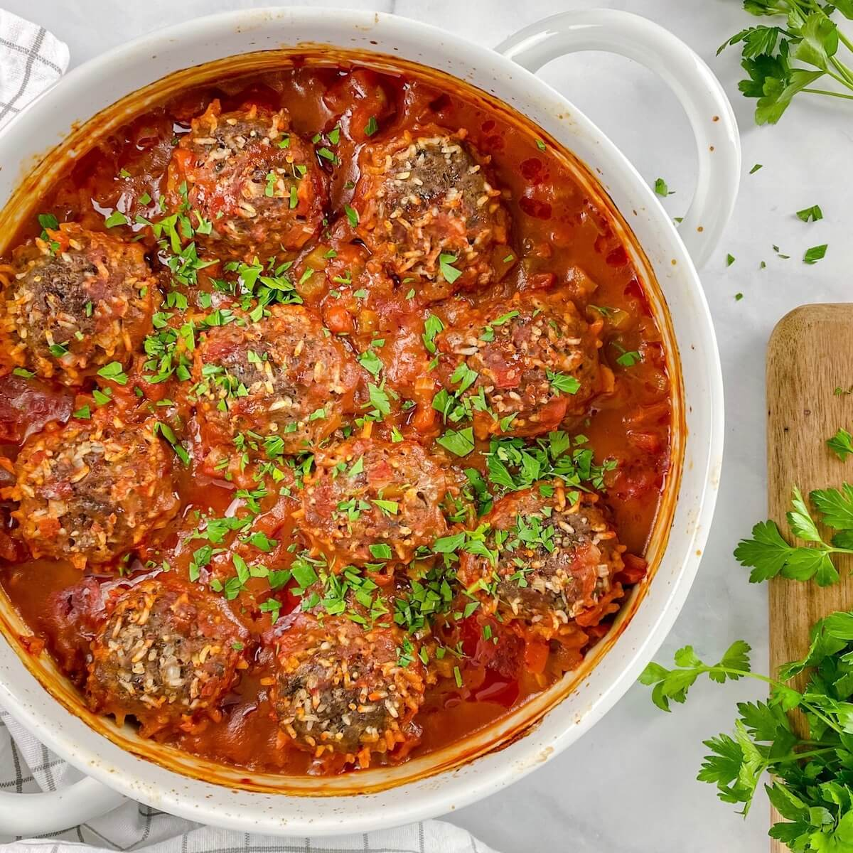 feature image of porcupine balls with rice cooked inside in tomato sauce