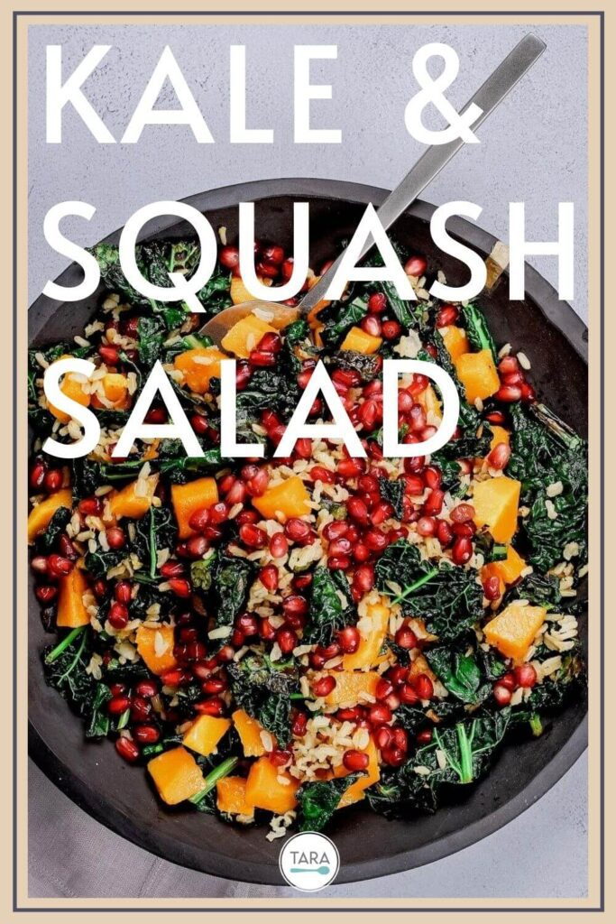 pin for kale and squash salad with brown rice and pomegranates in a slate bowl