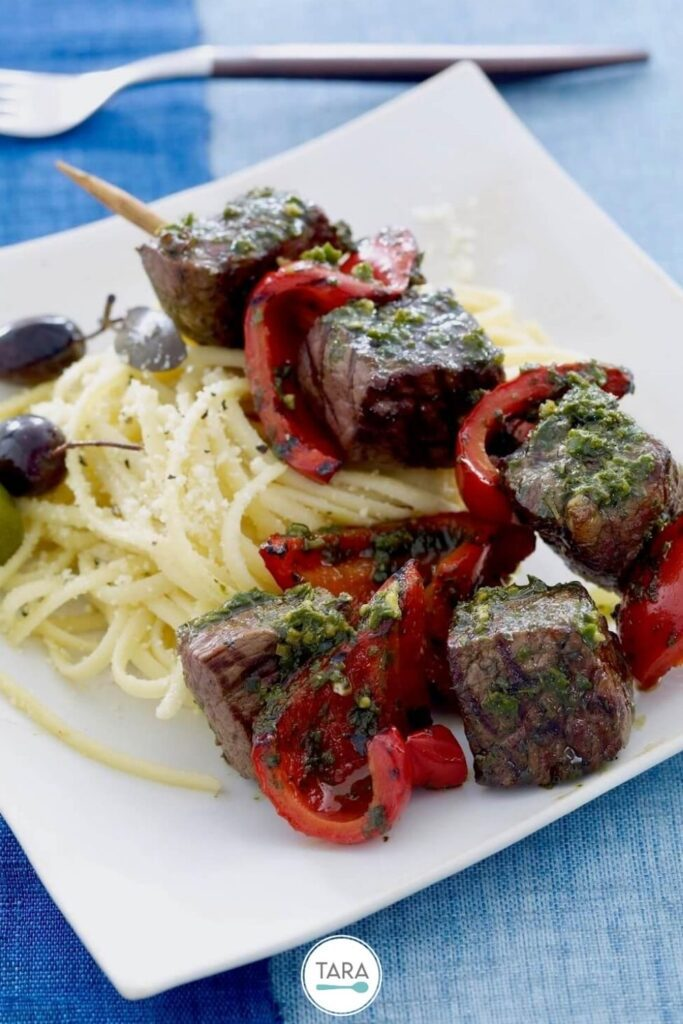 pin for bell pepper and steak kebabs with pasta side dish