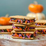 feature image of graham cracker cookies with chocolate frosting and Halloween sprinkles