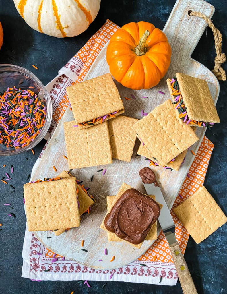 process of how to make graham cracker cookies with Halloween sprinkles