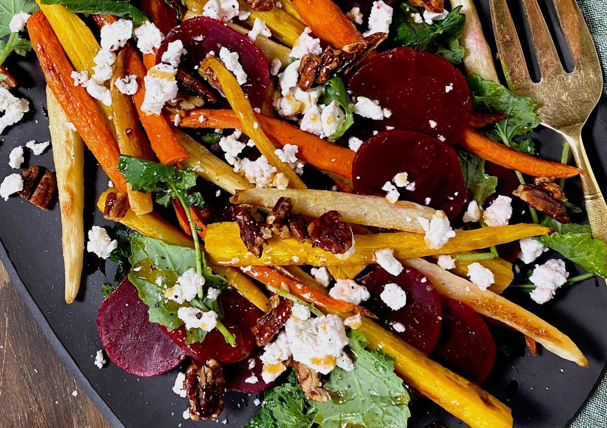 close up of roasted carrots and beets with goat cheese