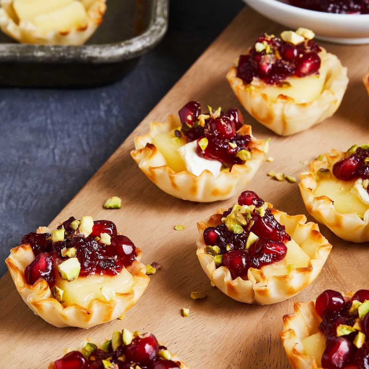 tartlets with brie and onions with pomegranates