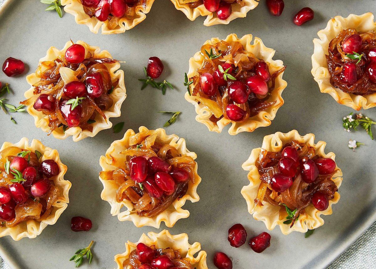 french onion tartlets with pomegranates