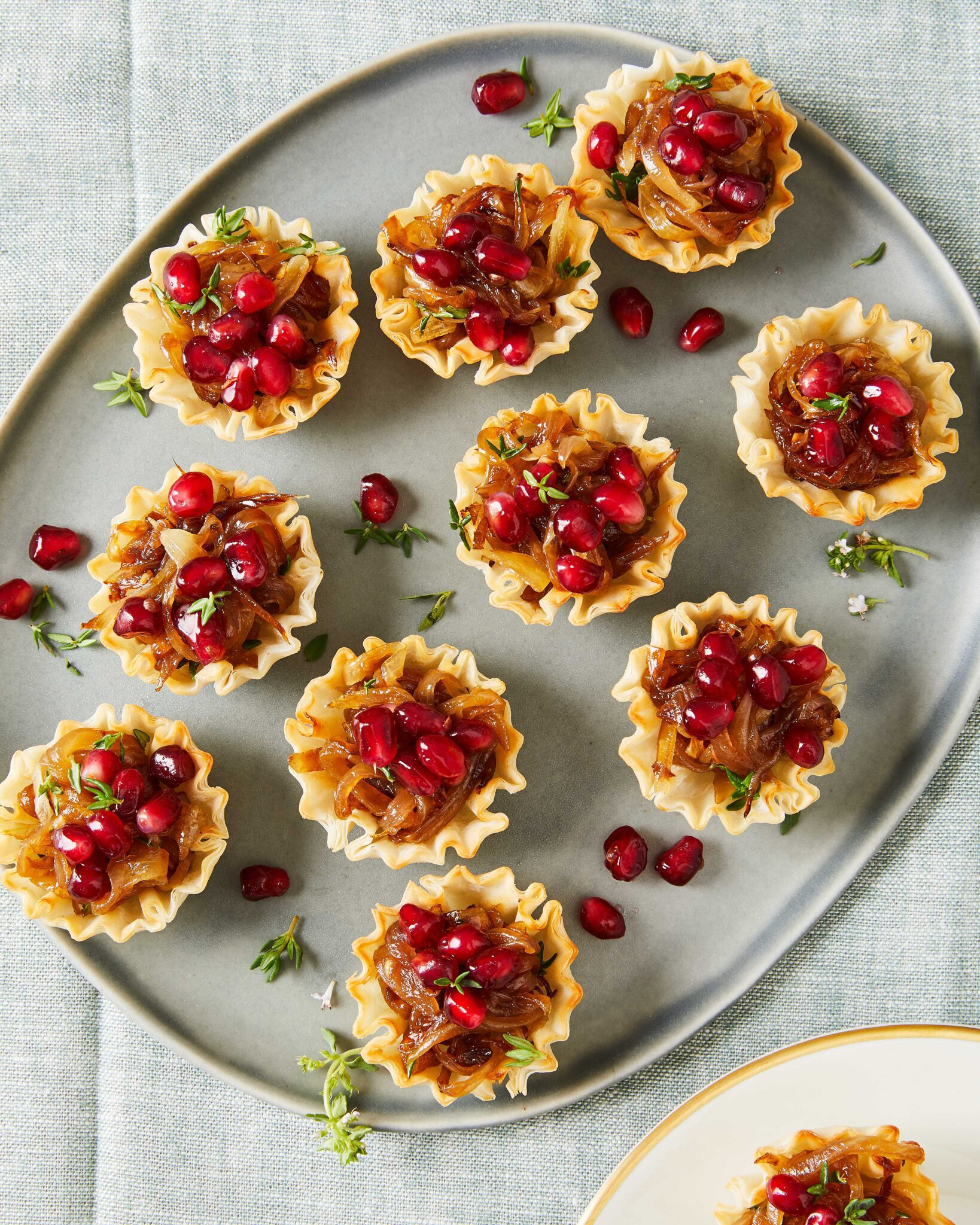french onion tarts with cheese and fruit