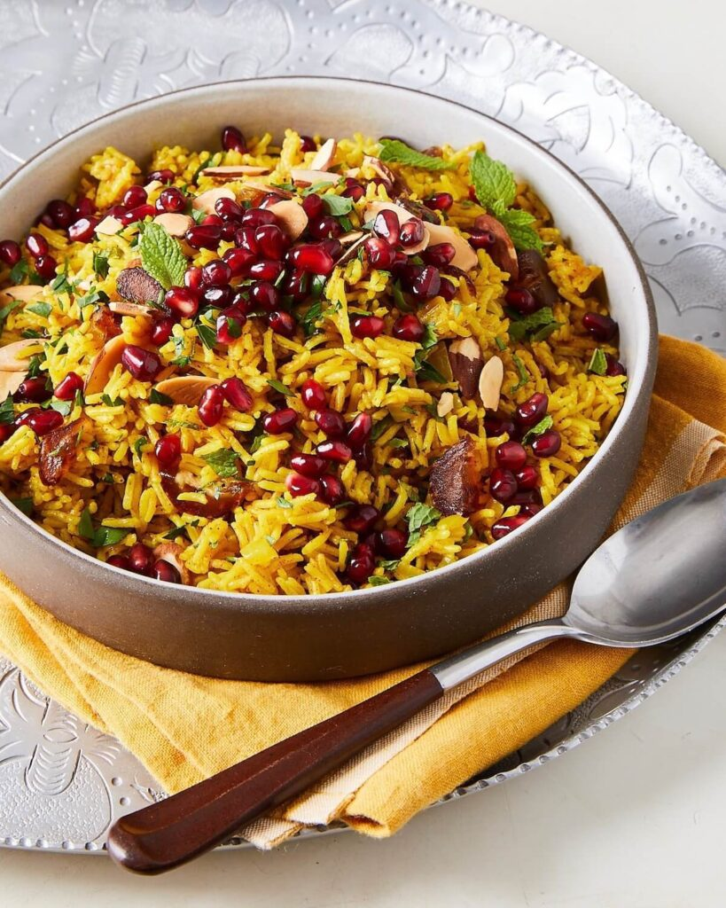 yellow rice side dish with dates and pomegranates