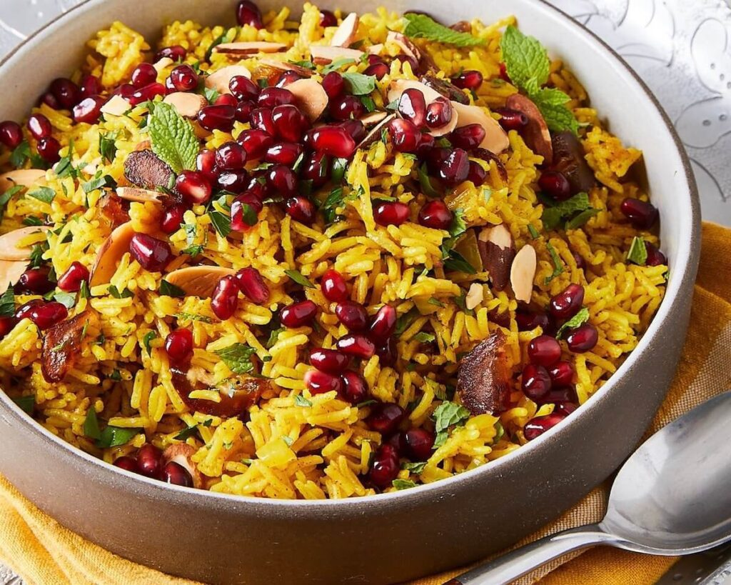 yellow Mediterranean rice with pomegranates in a ceramic dish