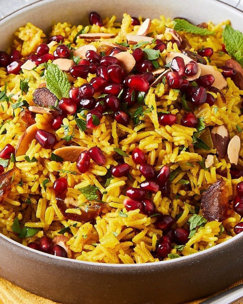 Mediterranean rice with dates and pomegranates in a brown dish