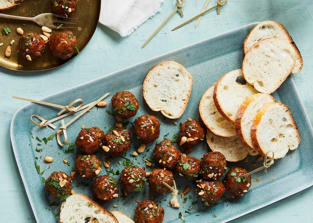Moroccan spiced meatballs with bread on a platter