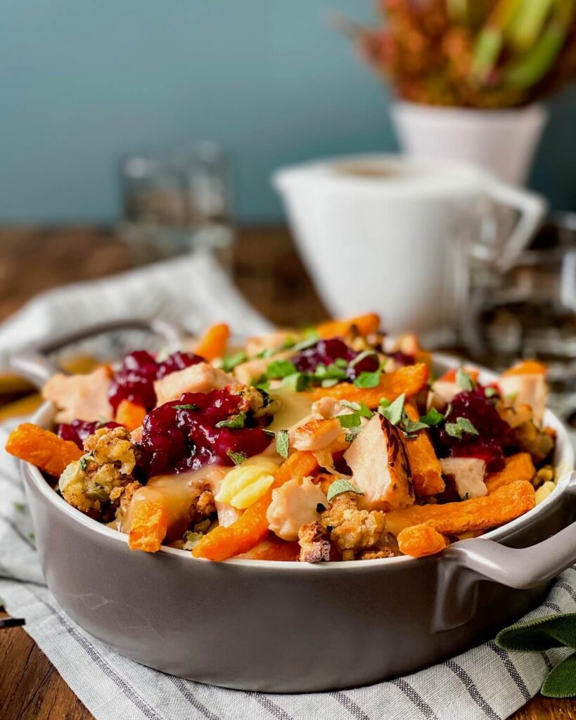 sweet potatoes poutine in baking dish with gravy boat