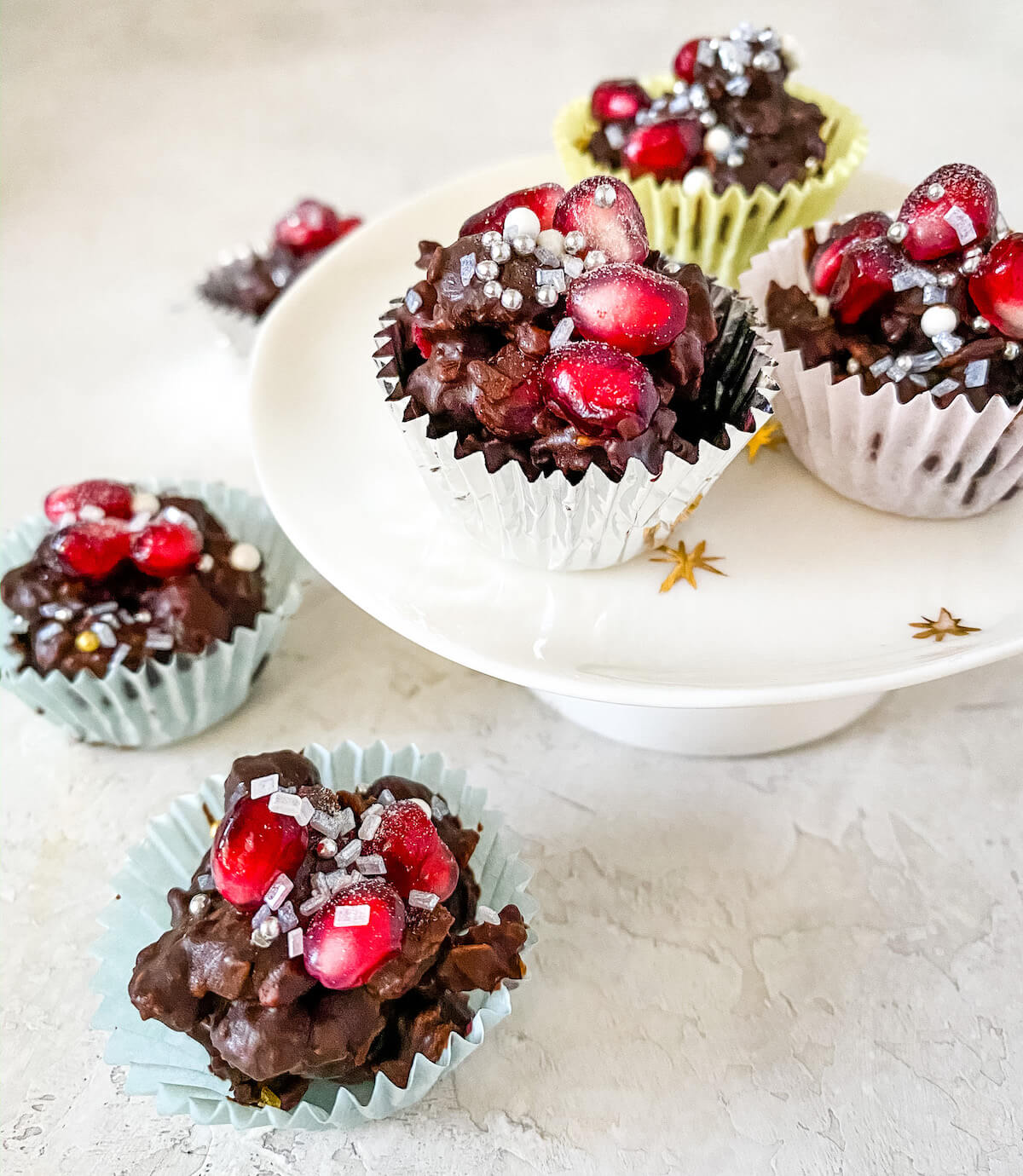coconut and granola chocolate clusters with pomegranate