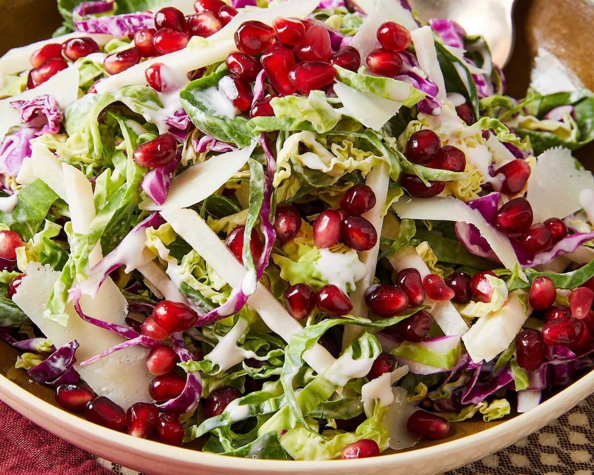 close up of shredded brussel sprouts and pomegranates